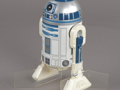 An R2-D2 action figure issued for The Empire Strikes Back. Credit: National Air and Space Museum.