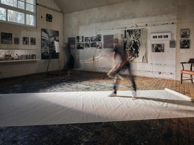 """""""The paint went all over, and of course some of it went off the canvas,"""" the photographer says of Pollock's technique, re-enacted here in his studio."""