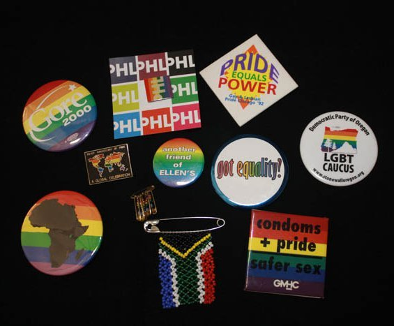 Collection of rainbow-printed buttons and pins
