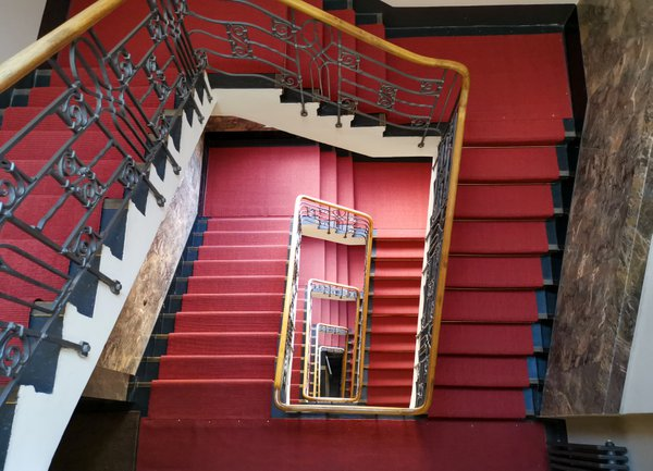 Stairwell with red carpet, staircase thumbnail
