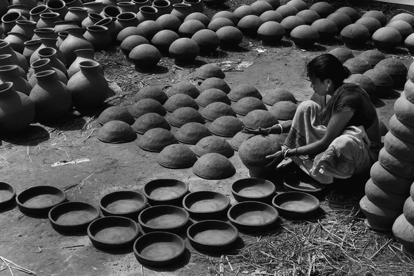 Pottery Womens are not behind. They are also helping their husband to making clay pots. thumbnail