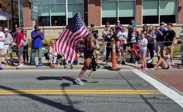 A Patriot running in the Boston Marathon thumbnail