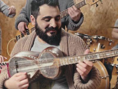 Miqayel Voskanyan plays the tar, an Armenian folk instrument.