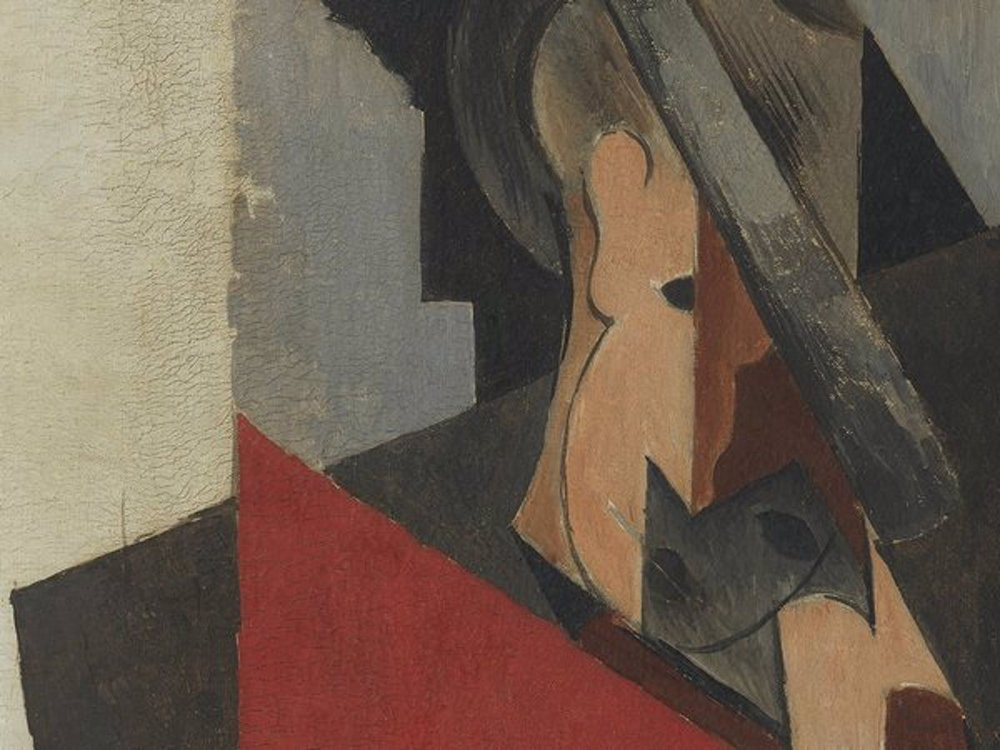 A close up of a man's Cubist portrait, who appears to be wearing a hat and is composed of angular shapes; various cracks are visible