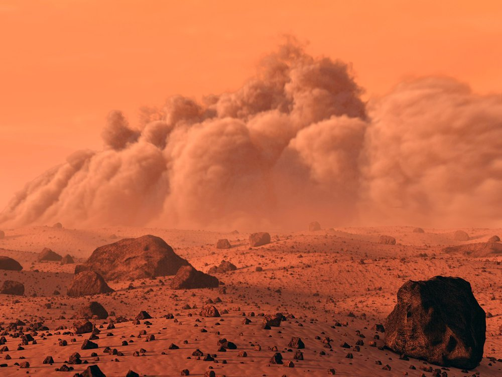 An auburn-colored ominous Martian landscape with a dust cloud rolling in.