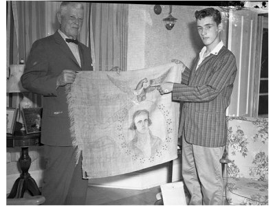 Clarence Barnes and Craig Wade with the banner in the Wade family home.