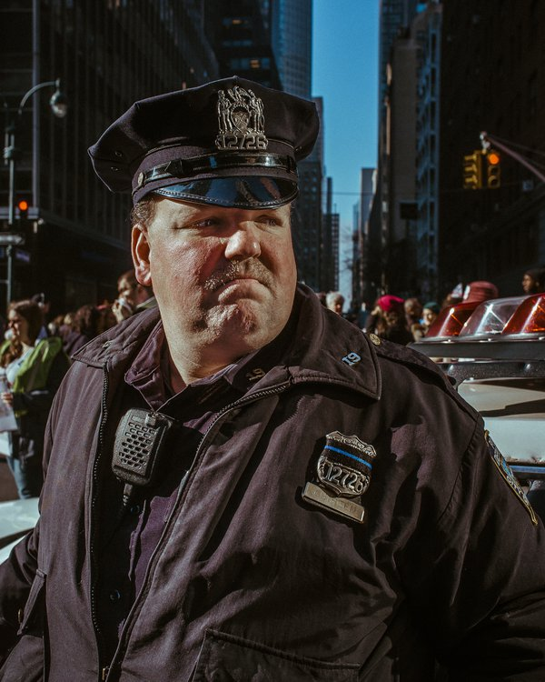 A police officer stays alert during the 2017 Women's March in NYC thumbnail