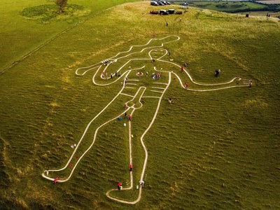 Volunteers repair and re-chalk the Cerne Abbas Giant in Dorset, England. The 180-foot figure has been on the grassy hillside as long as anyone alive can remember, but many wondered if it might be thousands of years old. Now, new evidence suggests the drawing dates not to the prehistoric period, but to medieval times.