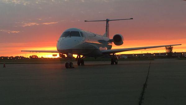 A beautiful sunrise behind the ERJ-145 thumbnail