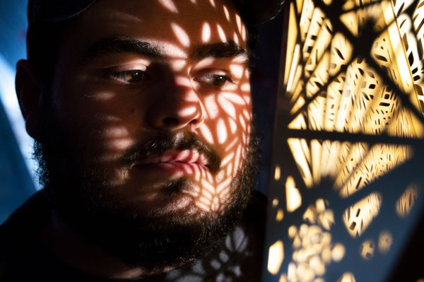 Reflection of geometrical light on man's face. thumbnail