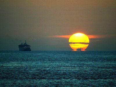 Sunrise over the Straits of Malacca.