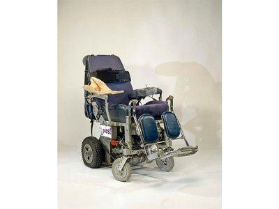 Roberts' wheelchair sports a reclining seat, a headlight for nighttime driving and a space in the back for a respirator and a small portable ramp.