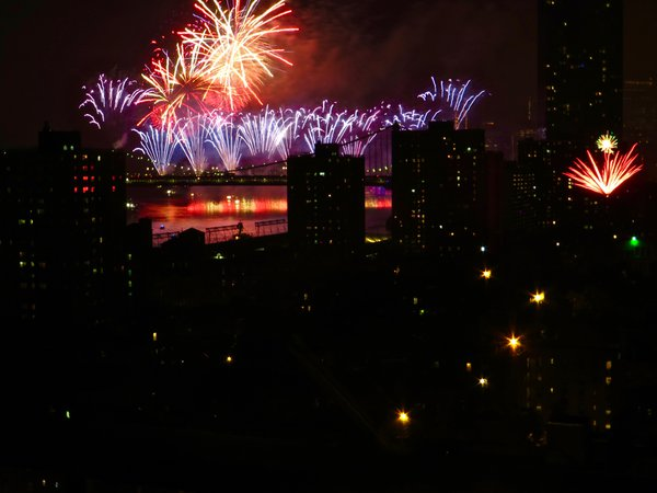 4th of July Fireworks explode over the East River in NYC thumbnail