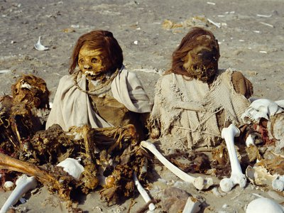 Ancient mummified bodies stand guard over windswept deserts near the Nazca and Ica mountain summits.