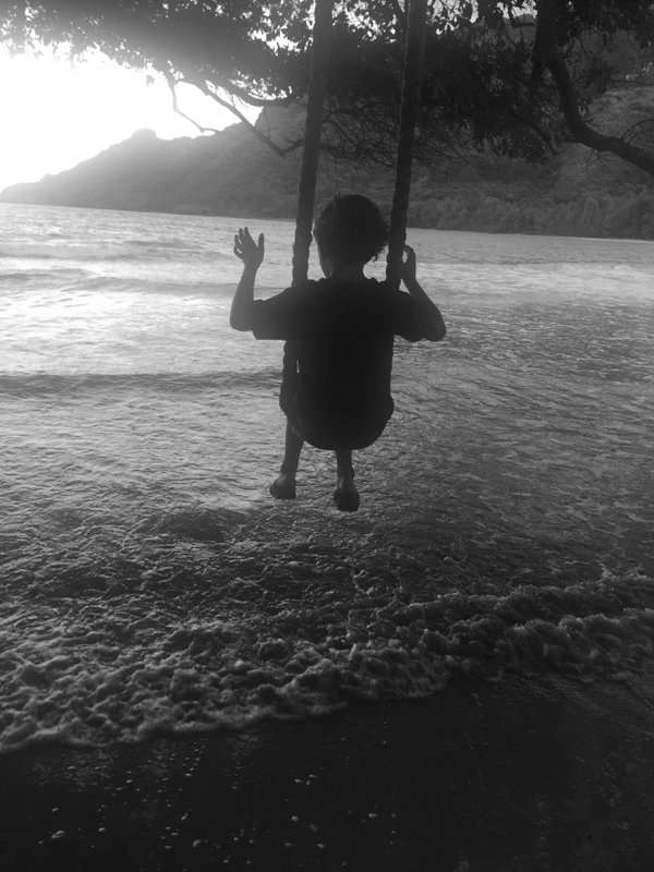 letting go, swinging at the beach  thumbnail