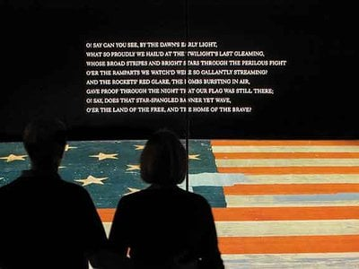 """By the """"dawn's early light,"""" Key saw the huge garrison flag, now on view at the National Museum of American History, waving above Fort McHenry and he realized that the Americans had survived the battle and stopped the enemy advance."""