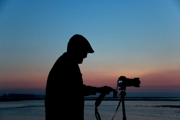 Silhouette of man in front of the sunset thumbnail