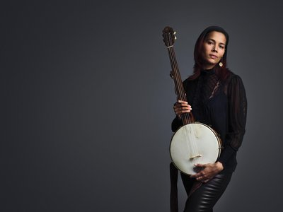 Giddens with her beloved cherry, maple and rosewood minstrel banjo, a replica of a design by the 19th-century Baltimore luthier Levi Brown.