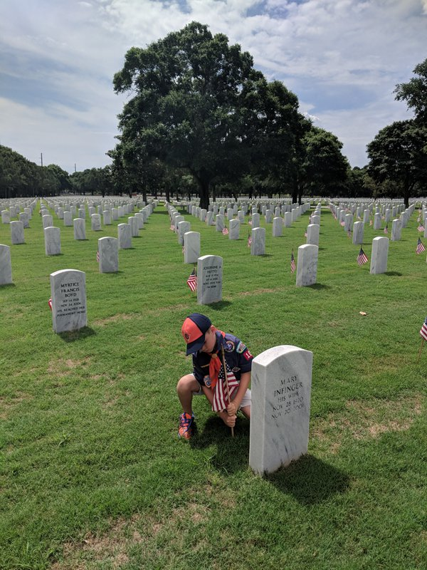 Cub scout honors fallen soldiers at Ft Barrancas National cemetery thumbnail