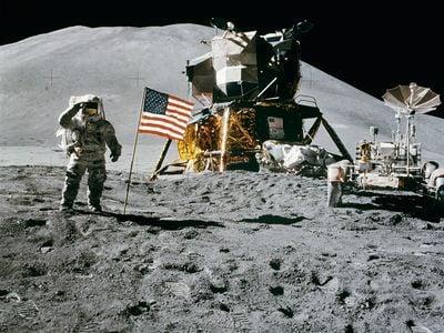 Apollo 15 Lunar Module Pilot James Irwin salutes the U.S. flag. This photograph was taken by Astronaut David R. Scott, Apollo 15 commander.