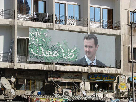 A poster for Syrian President Bashar al-Assad hangs in Damascus.