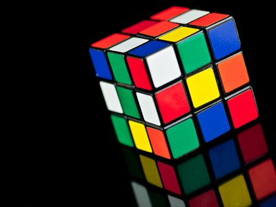 To solve the puzzle, you must twist the cubes so that eventually each side returns to its original color: The challenge is the astounding number of potential variations — more than 43 quintillion of them.