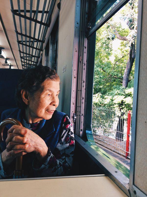 Grandma sitting in the Hong Kong Railway Museum thumbnail