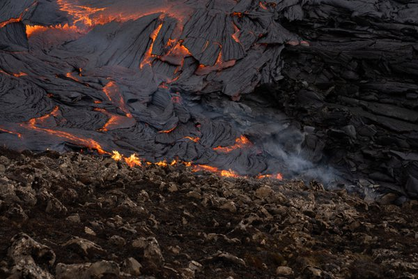 Fresh lava covering land in Iceland thumbnail