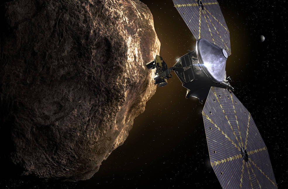 An artist rendering of NASA's Lucy space craft orbiting near one of the Trojan Asteroids