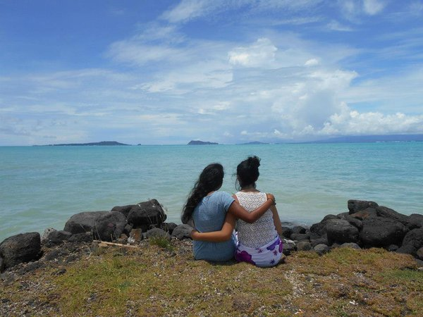 Taking in the breathtaking view of 3 Samoan islands, Manono, Apolima, and Savai'i, from the coast of the main island, Upolu, with my friend Valeria. thumbnail