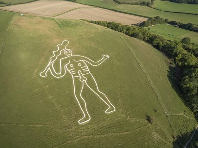 Researchers have long debated the Cerne Abbas Giant's age, with some dating it to the prehistoric period and others to the medieval era.