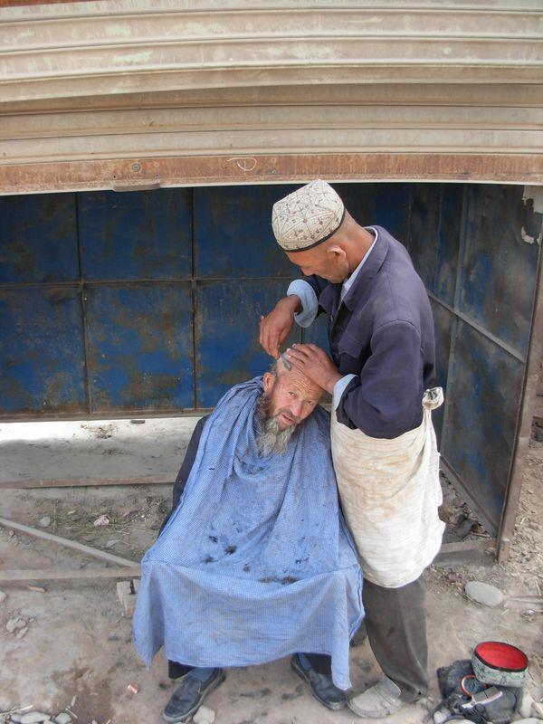 Gentleman getting a shave and haircut just outside the Sunday Livestock Market in Kashgar, Xinjiang, China. thumbnail