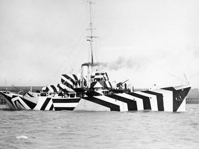 Photograph of British Kil class patrol gunboat HMS Kildangan painted in dazzle camouflage.
