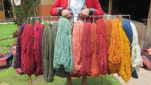Andean Woman Displays Her Colorfully Dyed Wools thumbnail