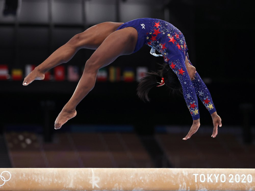 Simone Biles competes on the balance beam at the Tokyo 2020 Olympics