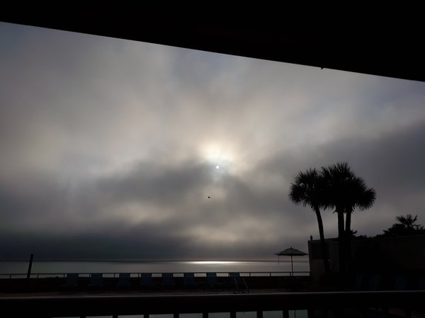 Moon kissed by the sun. Bright moon with sunrise, while having breakfast at Daytona Beach  thumbnail