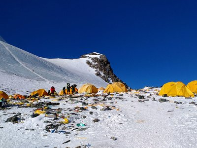 """Climbing equipment and trash scattered a camp on Mount Everest, according to AFP. Some are calling the mountain """"world's highest rubbish dump."""""""