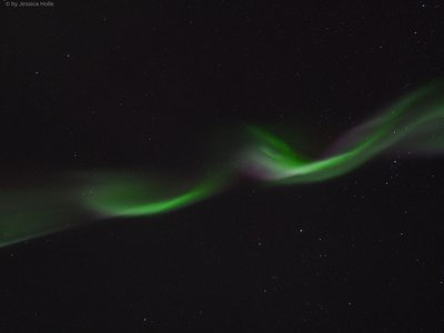 A multihued aurora ripples across the night sky over Tromsø, Norway, on January 19. Auroras happen when high-energy particles from the sun slam into Earth's atmosphere, exciting gas molecules in the air and causing them to emit light. The colors seen depend on the type of molecules involved and the altitude at which the most interactions are happening. Green is the most common shade for auroras and is produced by oxygen molecules at relatively low altitudes—between 62 and 186 miles.