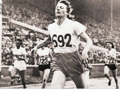 Fanny Blanker-Koen crosses the finish line to become the first triple champion of the 14th Olympic Games.