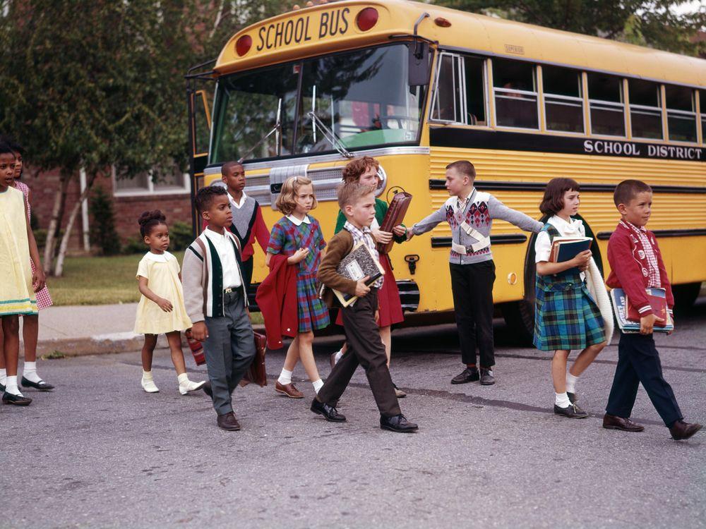 1960s school bus and school children
