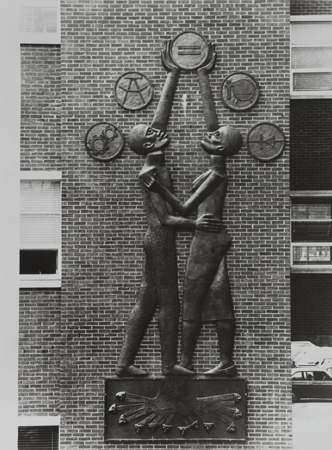 Elizabeth Catlett's sculpture Students Aspire on the campus of Howard University