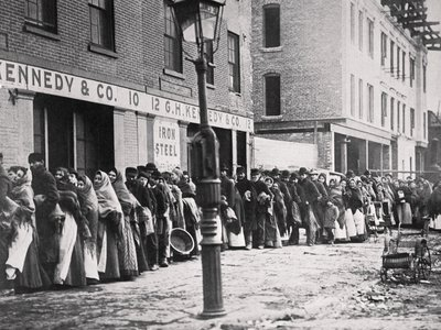 Men and women lining up during the 1902 Coal Strike for their allotment of coal.