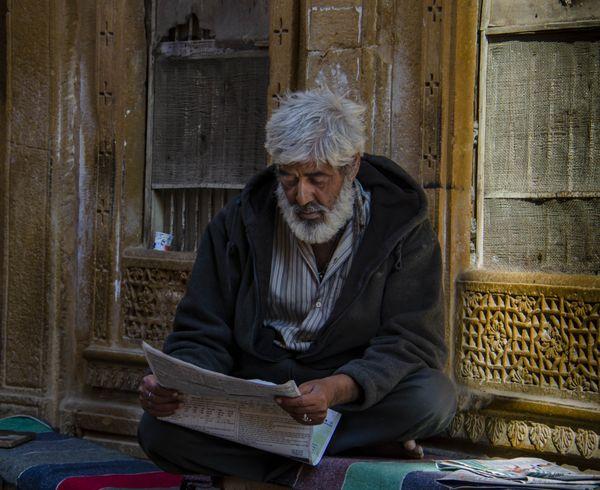 Man reading Newspaper thumbnail