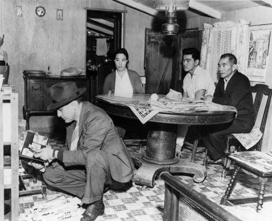 FBI agent searches house while Japanese American family looks on