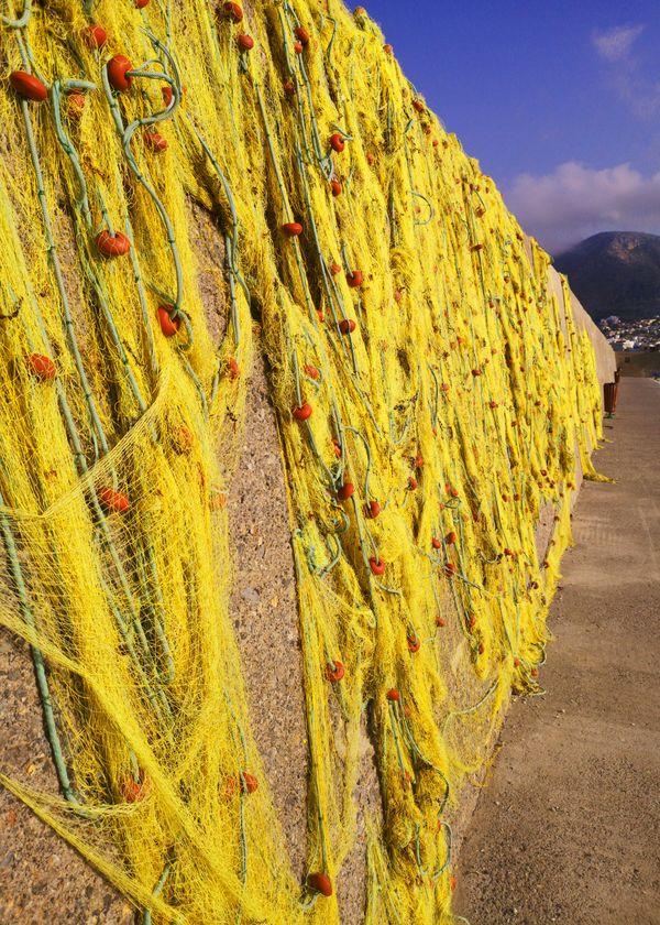 Fishing nets on the breakwater thumbnail