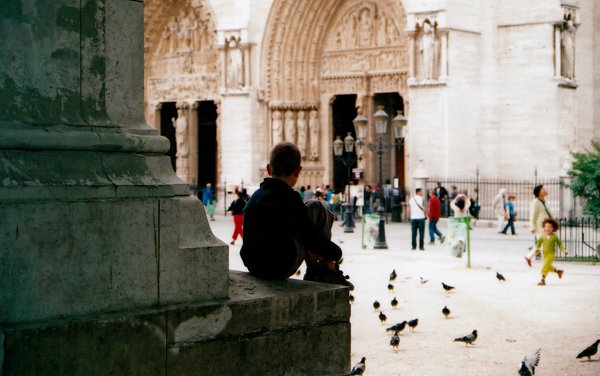 A boy waiting to see Notre Dame. thumbnail