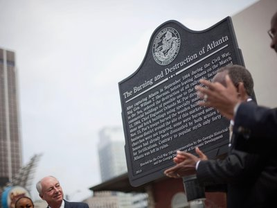 A civil war marker in commemoration of the Battle of Atlanta is unveiled as Georgia Historical Society board member Bill Todd, left, looks on during a ceremony Monday, April 11, 2011 in Atlanta.