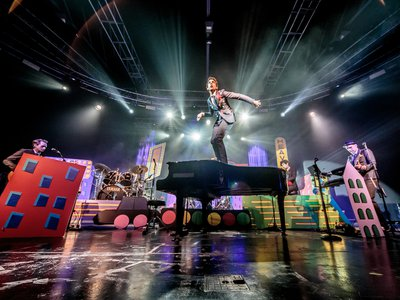 Lebanese-British singer-songwriter Mika performs atop a piano at Fabrique in Milan this June.