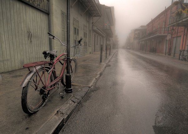 an empty french quarter street in foggy New Orleans. thumbnail