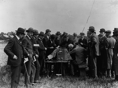 A group waits for news out of Versailles by a wireless Marconi radio, June 1, 1919.